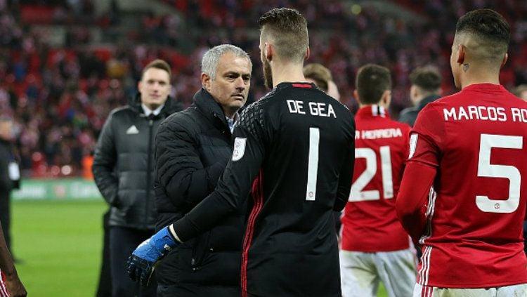 Jose Mourinho dan David De Gea. Copyright: © John Patrick Fletcher/Action Plus via Getty Images