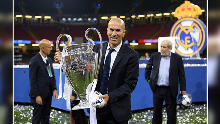 Pelatih Real Madrid, Zinedine Zidane sukses mengantarkan tim besutannya juara Liga Champions 2016/17. Copyright: © getty images