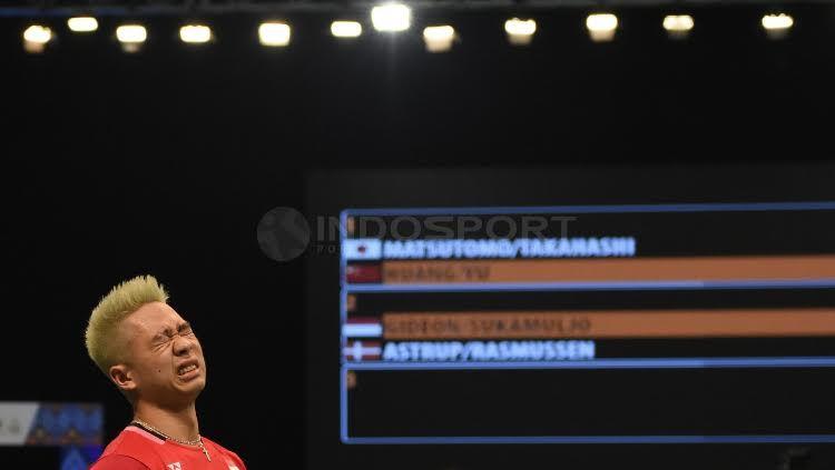 Ekspresi Kevin Sanjaya di laga Indonesia Open 2017. Copyright: © Herry Ibrahim/Indosport