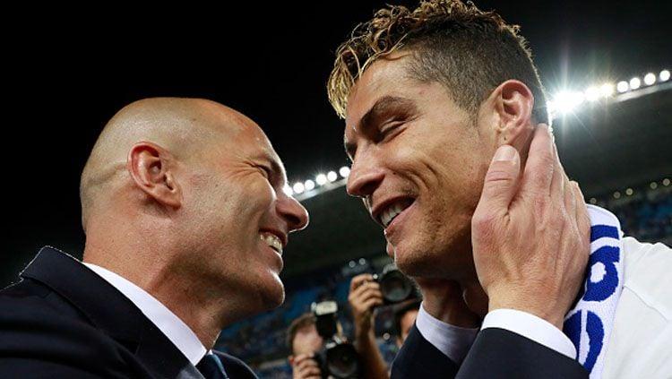 Zinedine Zidane bereaksi ini ketika Cristiano Ronaldo dikabarkan bakal tinggalkan Juventus dan pulang lagi ke raksasa LaLiga Spanyol, Real Madrid. Copyright: © Getty Images