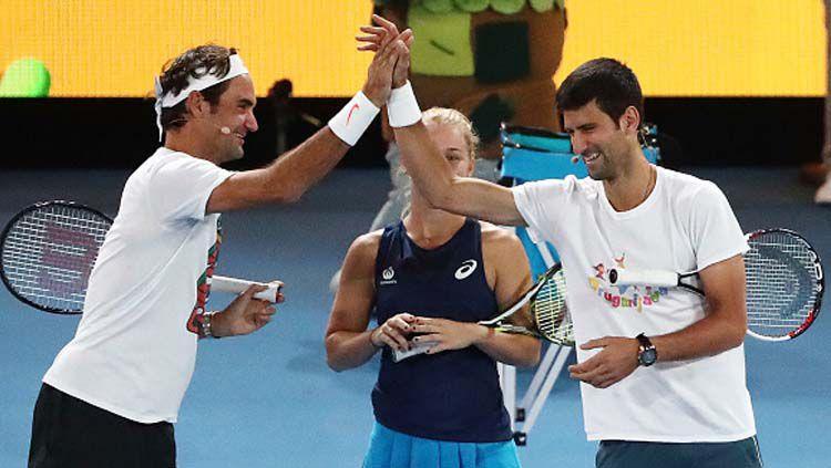 Novak Djokovic dan Roger Federer. Copyright: © INDOSPORT