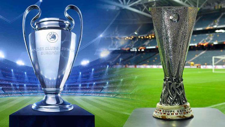 Tropi Liga Champions dan Liga Eropa. Copyright: Indosport.com