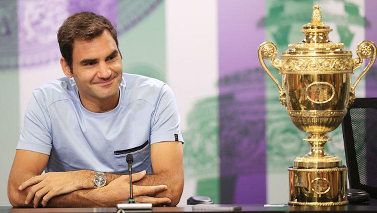 Roger Federer ternyata membawa berkah bagi rekannya sesama petenis. Copyright: © INDOSPORT