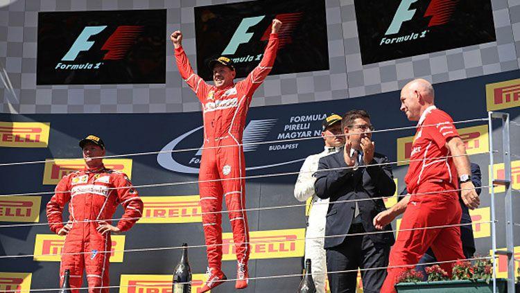Pembalap Ferrari, Sebastian Vettel, memenangi balapan Formula 1 GP Hungaria di Sirkuit Hungaroring. Copyright: © INDOSPORT