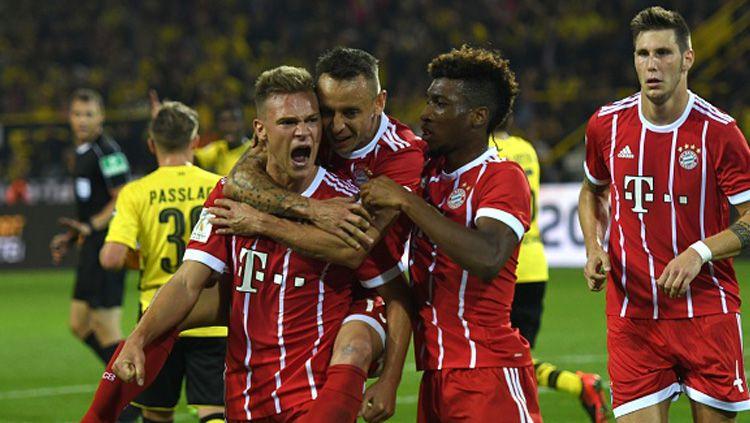 Selebrasi para pemain Bayern Munchen usai mencetak gol ke gawang Dortmund. Copyright: © INDOSPORT