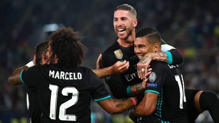 Selebrasi pemain Real Madrid setelah Casemiro cetak gol. Copyright: © INDOSPORT