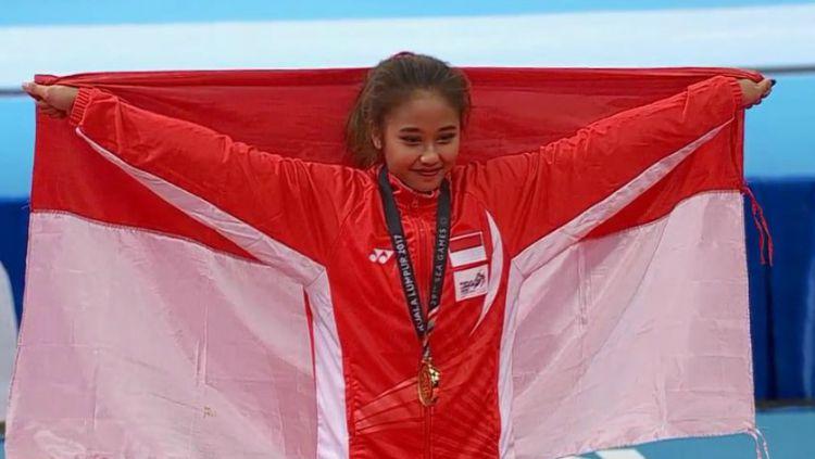 Pesenam Indonesia, Rifda Irfanaluthfi, berhasil meraih medali emas di cabang senam artistik nomor vault, Selasa (3/12/19), di Rizal Memorial Coliseum, Filipina. Copyright: © Vidio.com