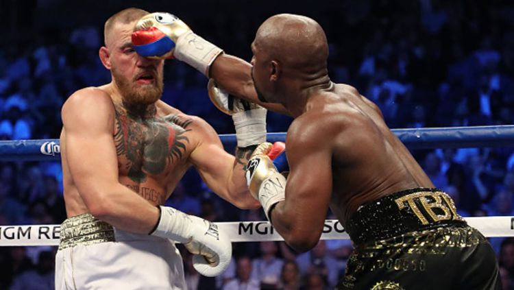 Floyd Mayweather Jr vs Conor McGregor. Copyright: © Indosport.com