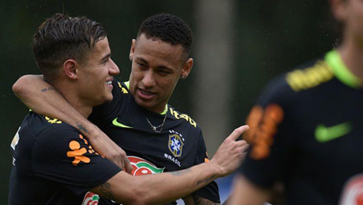 Philippe Coutinho dan Neymar Jr. Copyright: © getty images