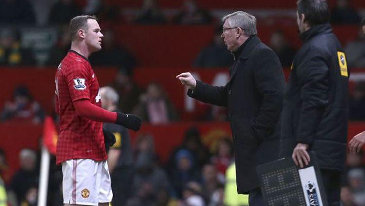 Sir Alex Ferguson memberikan prediksi yang mengejutkan menyusul keputusan Wayne Rooney untuk menjadi pelatih usai memutuskan untuk pensiun. Copyright: © getty images