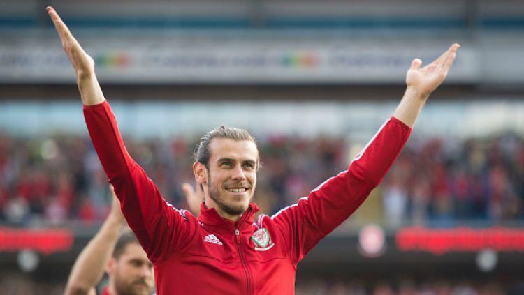 Bintang klub Liga Spanyol, Gareth Bale saat memperkuat Timnas Wales. Copyright: © getty images