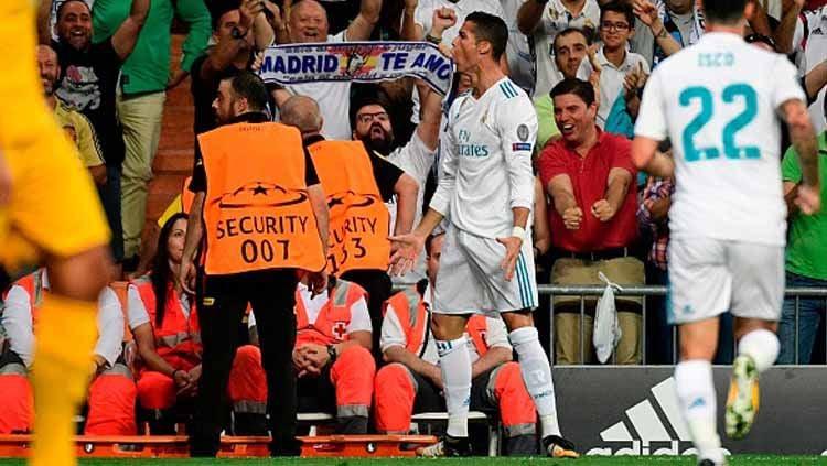 Selebrasi pemain megabintang Real Madrid, Cristiano Ronaldo usai menjebol gawang Apoel. Copyright: © getty images