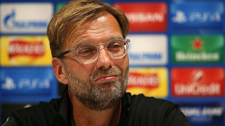 Jurgen Klopp angkat bicara soal hasil undian perempatfinal Liga Champions yang mempertemukan Liverpool dengan Porto. Copyright: © INDOSPORT