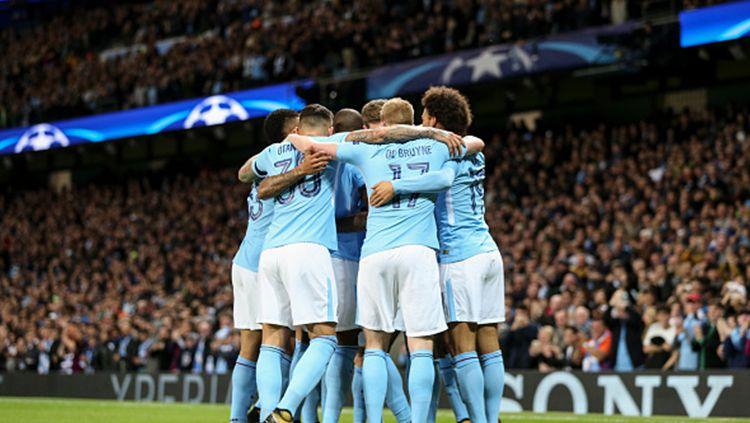 Para pemain Manchester City berselebrasi. Copyright: © INDOSPORT