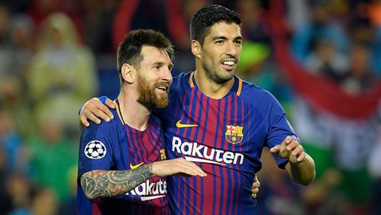 Lionel Messi menjadi sosok yang paling bersedih saat Luis Suarez meninggalkan Barcelona untuk gabung ke Atletico Madrid musim panas ini. Copyright: © INDOSPORT