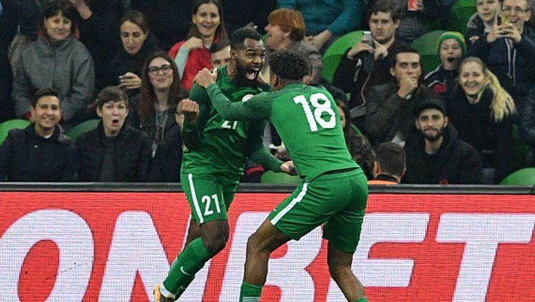Pemain Timnas Nigeria berselebrasi usai cetak gol lawan Timnas Argentina. Copyright: © INDOSPORT