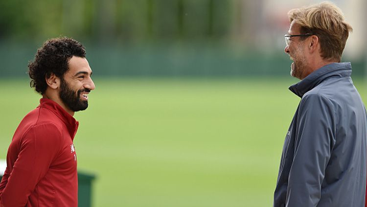 Jurgen Klopp dan Mohamed Salah. Copyright: © Getty Images