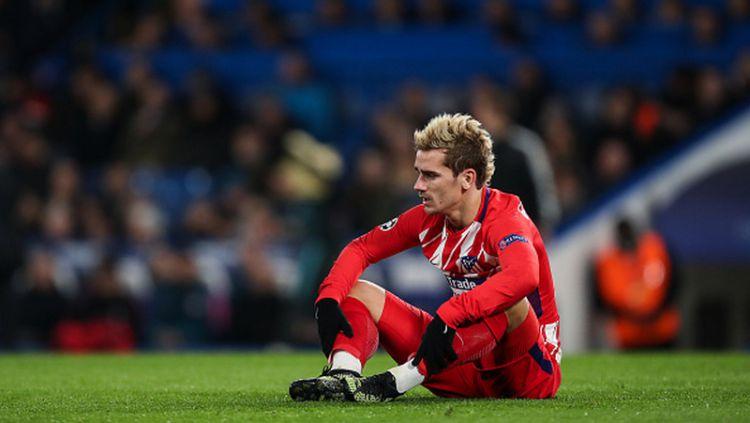 Antoine Griezmann pasrah pasca timnya gagal lolos dari penyisihan Grup Liga Champions. Copyright: © INDOSPORT