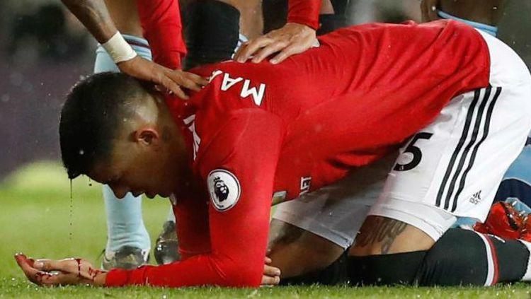 Marcos Rojo, pemain Manchester United yang posisinya kini tergantikan oleh seorang Harry Maguire. Copyright: © the Sun