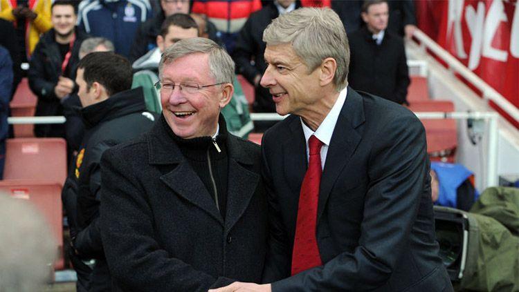 Manajer Arsenal, Arsene Wenger resmi melewati rekor Alex Ferguson di Liga Primer Inggris. Copyright: © internet