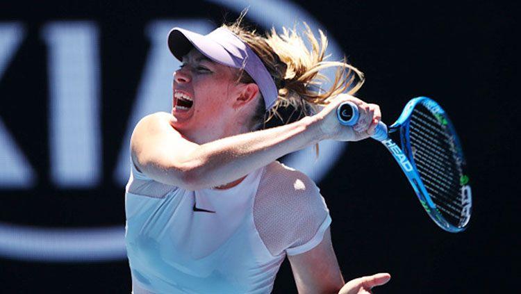 Maria Sharapova mengembalikan bola kepada lawan di ajang Australia Open 2018. Copyright: © Getty Images