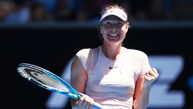 Maria Sharapova saat selebrasi di ajang Australia Terbuka 2018. Copyright: © INDOSPORT