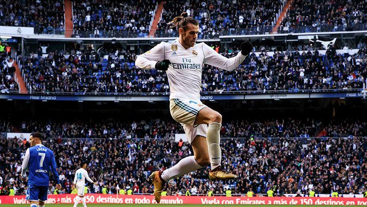 Gareth Bale saat melakukan selebrasi usai cetak gol ke gawang Deportivo La Coruna. Copyright: © Getty Images