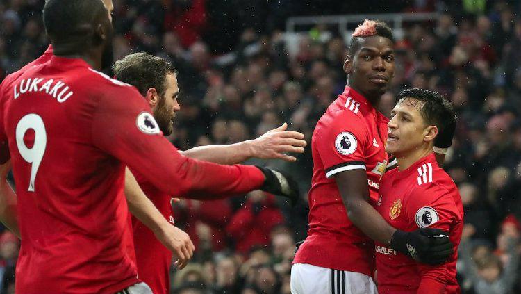 Skuat Manchester United saat merayakan gol ke gawang Huddersfield Town. Copyright: © Getty Images