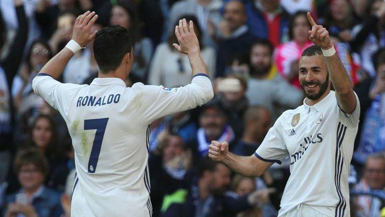 Setelah pergi dari raksasa LaLiga Spanyol, Real Madrid untuk gabung Juventus, sosok Cristiano Ronaldo ternyata masih bersemayam dalam diri Karim Benzema. Copyright: © Getty Images