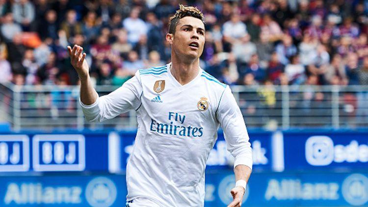 Selebrasi Cristiano Ronaldo usai mencetak gol ke gawang Girona. Copyright: © INDOSPORT