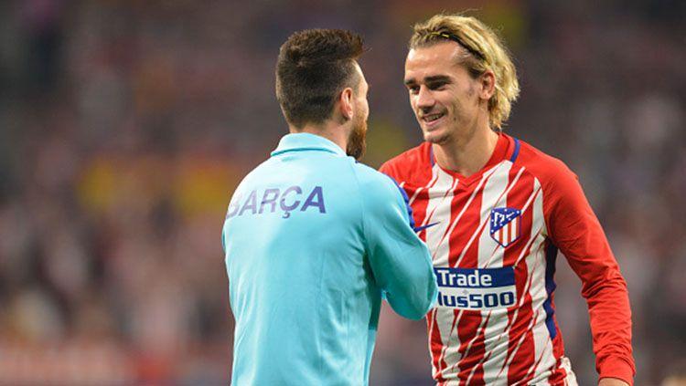 Lionel Messi ternyata hampir saja menjadi penyebab kegagalan transfer Antoine Griezmann ke klub raksasa LaLiga Spanyol, Barcelona. Copyright: © INDOSPORT