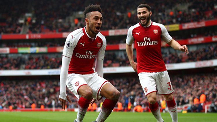 Aubameyang menjadi pemain kedua Arsenal yang mencetak gol ke gawang Watford di pekan ke-30 Liga Primer Inggris. Copyright: © INDOSPORT