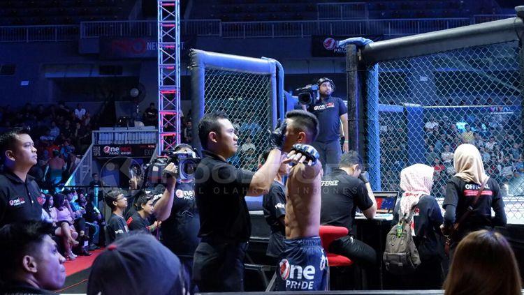 Kompetisi seni bela diri ONE Pride MMA resmi dibatalkan lantaran terkena dampak wabah virus corona (COVID-19) yang resmi telah ditetapkan menjadi pandemi global Copyright: © Alfia Nurul Fadill/INDOSPORT
