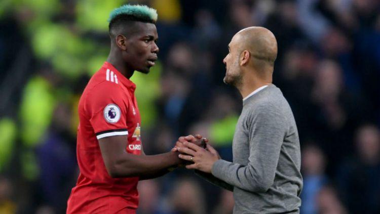 Dua tahun lalu, Paul Pogba menginspirasi Manchester United menunda pesta juara Manchester City di ajang Liga Inggris. Copyright: © Getty Image