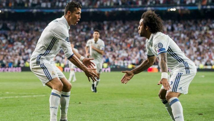 Ronaldo dan Marcelo berselebrasi pasca mengandaskan Bayern Munchen. Copyright: © Getty Images