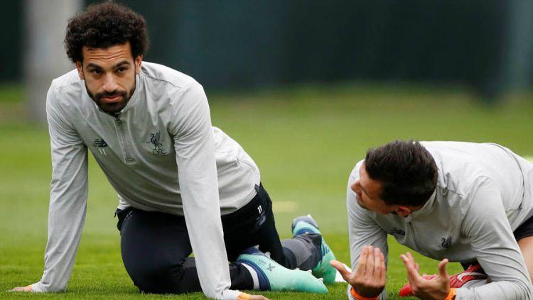 Mohamed Salah dan Dejan Lovren. Copyright: © Reuters