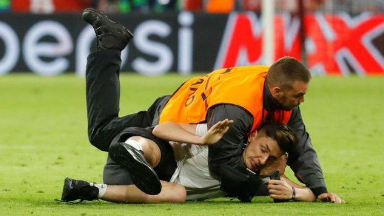 Suporter di laga Munchen vs Madrid. Copyright: © Reuters