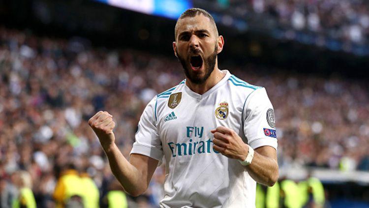 Pemain Real Madrid, Karim Benzema, berhasil mencetak rekor gol di pertandingan pekan ke-2 LaLiga Spanyol 2019/20 melawan Real Valladolid di Santiago Bernabeu. Copyright: © INDOSPORT