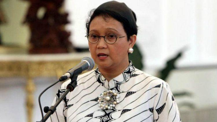 Menteri luar negeri, Retno Marsudi ternyata memiliki kedekatan dengan dunia olahraga. Ia bahkan menjadi penggemar dari Jonatan Christie. Copyright: © jateng.tribun