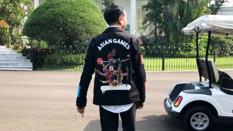 Jokowi gunakan jaket Asian Games. Copyright: © INASGOC