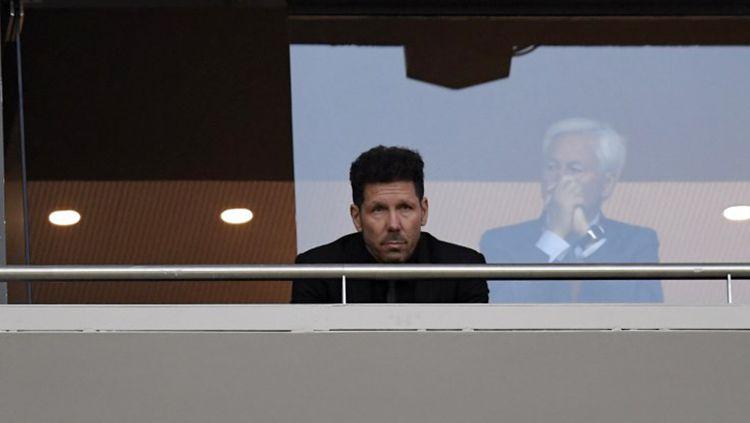Pelatih Atletico Madrd, Diego Simeone akan berada di bangku penonton di laga final Liga Europa. Copyright: © INDOSPORT