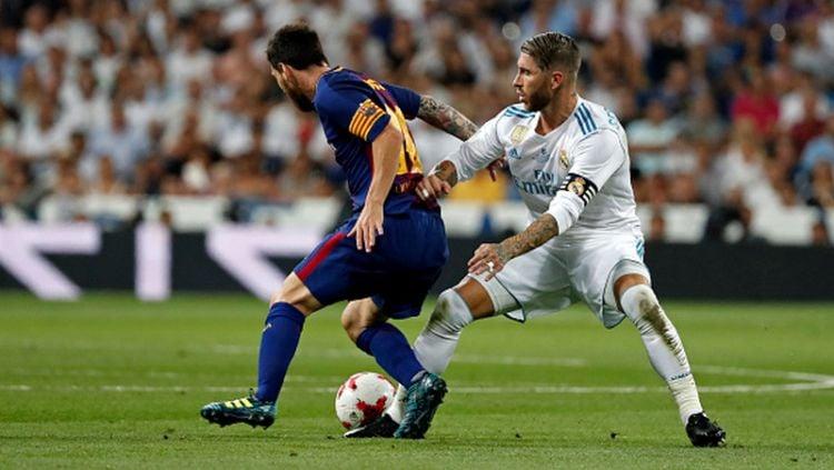 Paris Saint-Germain tengah di ambang pencapaian besar lewat hasratnya untuk menyatukan Sergio Ramos dan Lionel Messi dalam satu tim. Copyright: © INDOSPORT