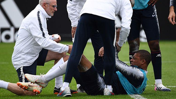 Kylan Mbappe alami cedera saat sesi latihan. Copyright: © INDOSPORT