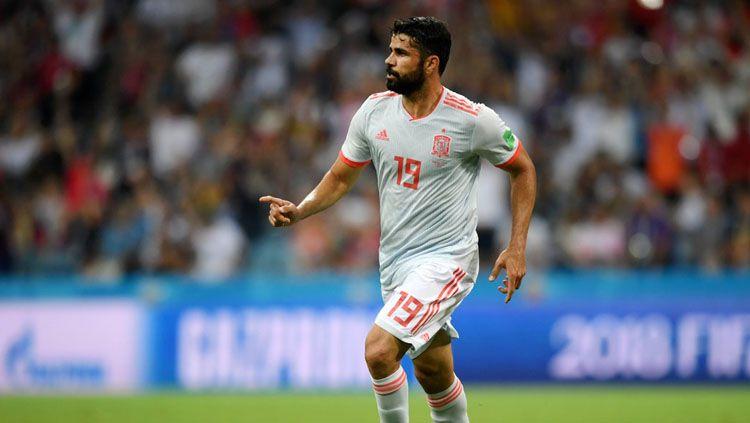 Diego Costa mencetak gol saat Spanyol berhadapan dengan Portugal di Piala Dunia 2018. Copyright: © Twitter @indyfootball