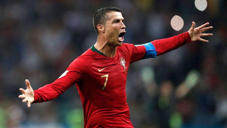 Selebrasi Cristiano Ronaldo setelah membobol gawang Spanyol di Piala Dunia 2018. Copyright: © Twitter @ChampionsLeague