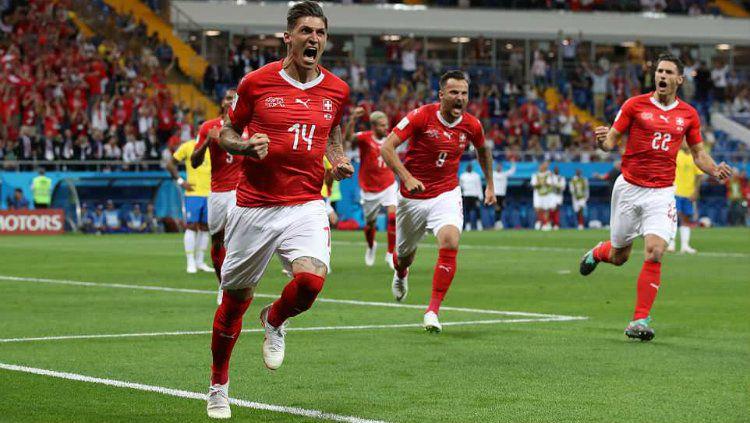 Momen ketika Steven Zuber meerayakan gol ke gawang Brasil di Piala Dunia 2018. Copyright: © Getty Images