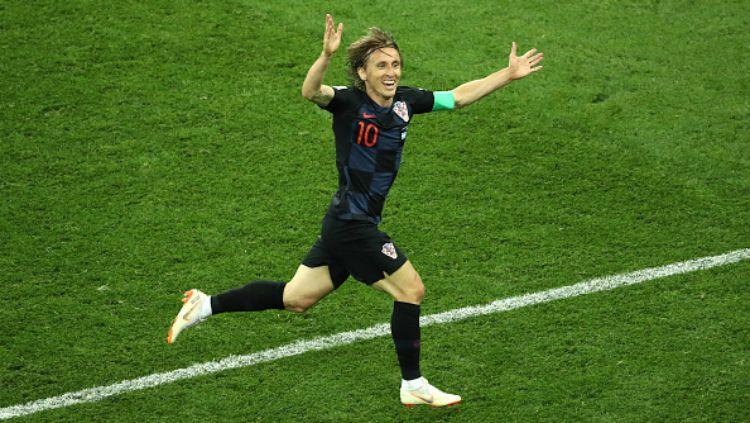 Luka Modric saat berlaga di Piala Dunia 2018 bersama Timnas Kroasia. Copyright: © INDOSPORT