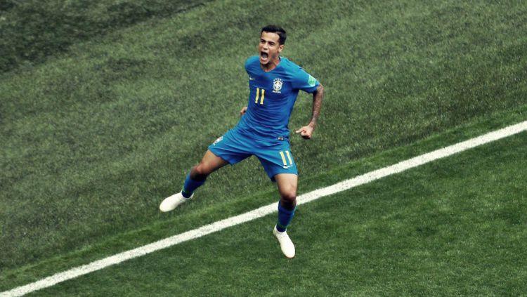 Indosport - Philippe Coutinho merayakan golnya ke gawang Kosta Rika di Piala Dunia 2018