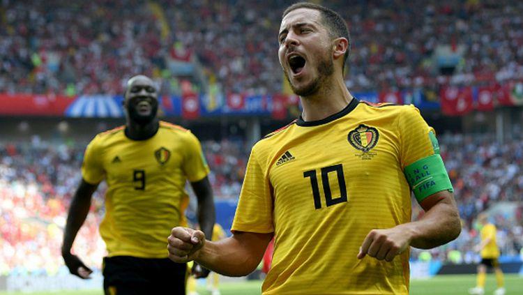 Eden Hazard merayakan golnya ke gawang Tunisia Copyright: © INDOSPORT