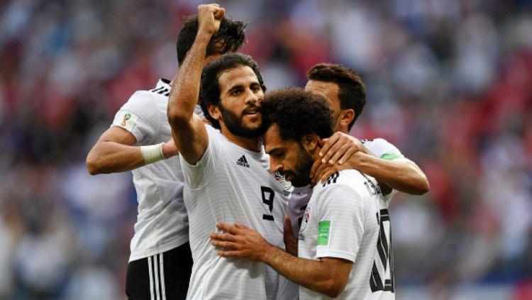 Mohamed Salah terlihat lesu walau mampu mencetak gol ke gawang Arab Saudi. Copyright: © Getty Images
